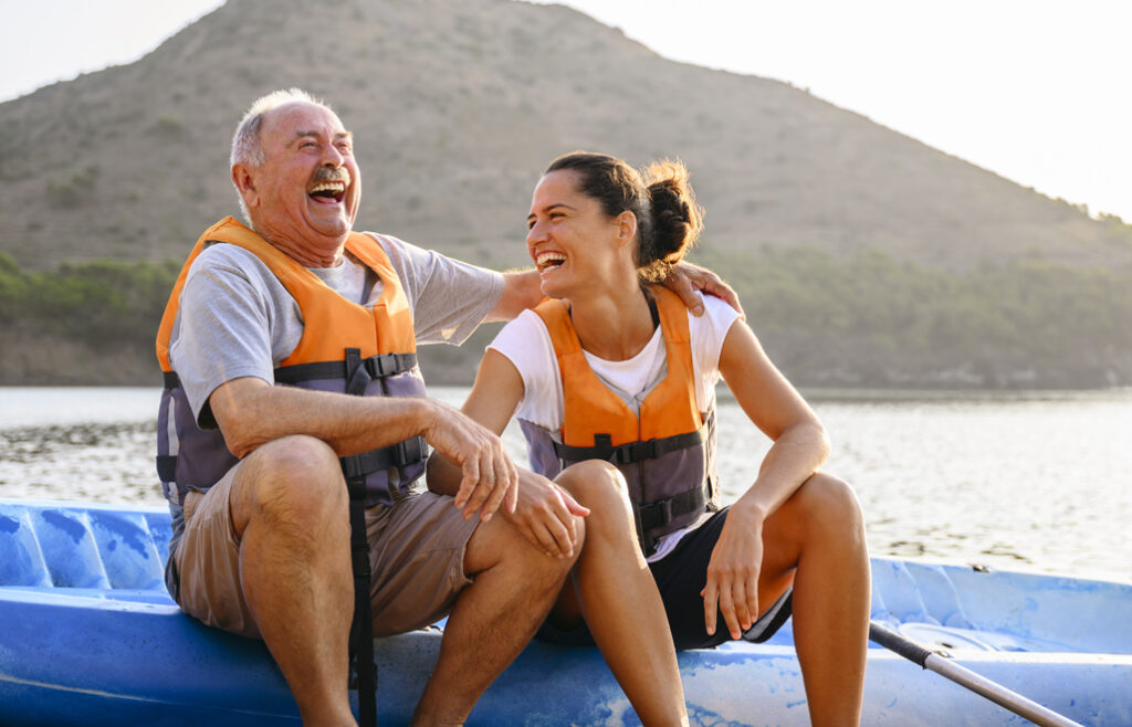 Woman and man laughing on a boat