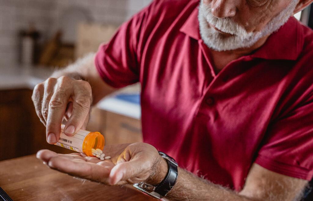 Man taking his prescription pills